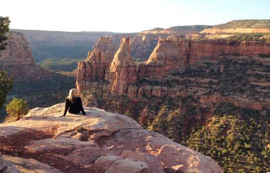 A woman admiring the Colorado National Monument outside Fruita.