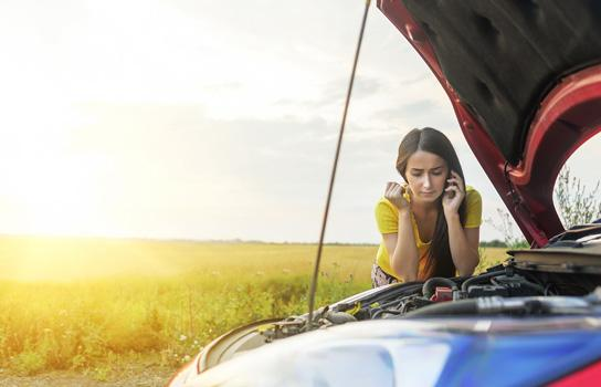 Frustrated motorist calling AAA Roadside Assistance, which provides towing, mobile battery service, gas, tires and more 24/7.