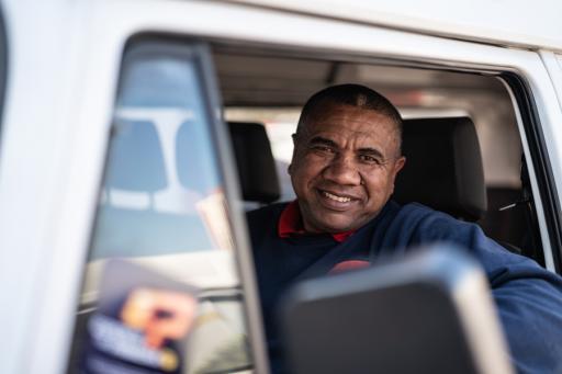 Retiree driving his pickup.